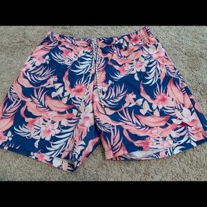 Large Floral Tommy Bahama swimming trunks.
